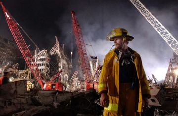 Bruce Stands In the Rubble of Ground Zero